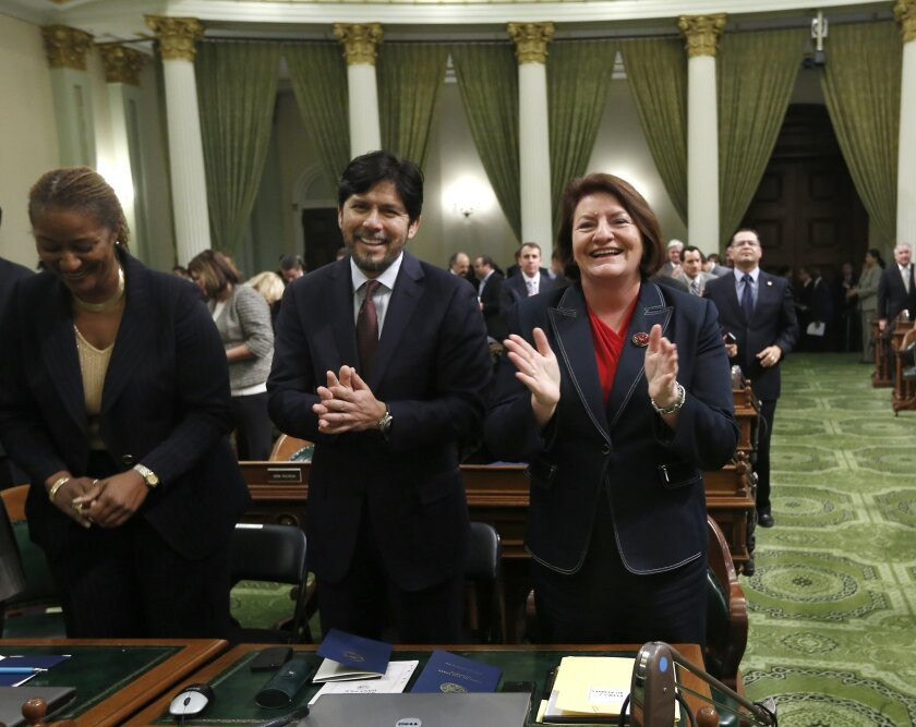 Sen. Kevin de Leon, D-Los Angeles, and Assemblywoman Toni Atkins, D-San Diego applaud Gov. Jerry Brown, before his annual State of the State Address before a joint session of the Legislature at the Capitol, Wednesday, Jan. 22, 2014 in Sacramento, Calif. Assembly Speaker John Perez, D-Los Angeles, a