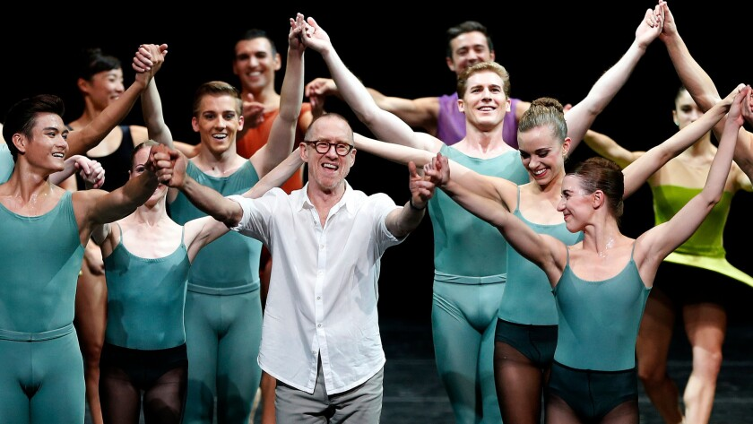 Choreographer William Forsythe, center, joins hands with members of the Houston Ballet, which danced his work with Pacific Northwest Ballet and San Francisco Ballet on Friday night at the Dorothy Chandler Pavilion in L.A.