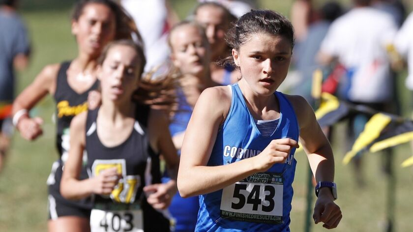 CDM's Annabelle Boudreau, 543, runs into the last leg of the Girls Sweepstakes race in the Orange Co