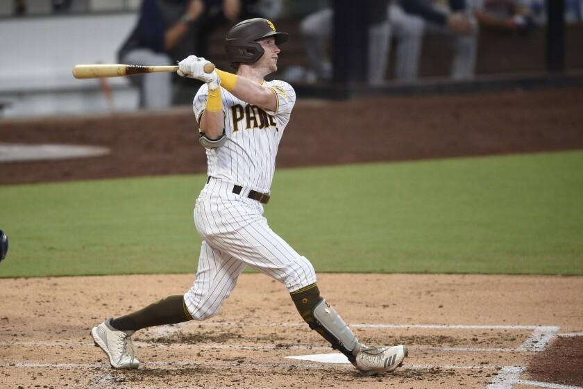 San Diego Padres' Jake Cronenworth watches his grand slam on Aug. 22