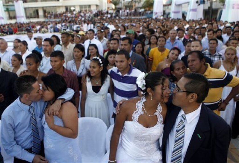 Couples participate in a mass wedding in Managua, Nicaragua, Thursday, Feb 14, 2013. A public square in Nicaragua has become an improvised wedding chapel for 550 couples who took their marriage vows on Valentine's Day in a mass wedding. Mass weddings have become a tradition in the Nicaraguan capita
