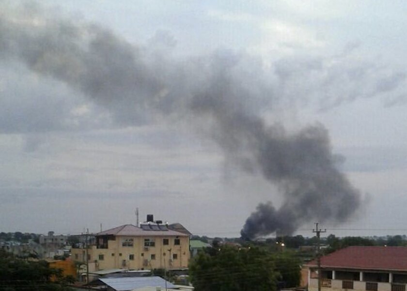 In this photo taken Sunday, July 10, 2016, black smoke is seen rising above the capital Juba, in South Sudan. Explosions and heavy weapons gunfire are shaking South Sudan's capital Juba Monday in the fifth day of clashes between government and opposition forces, raising the specter of a return to c