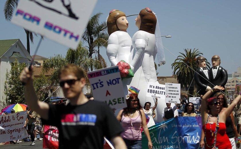 Last year's gay Pride parade along University Avenue drew roughly 200,000 spectators.