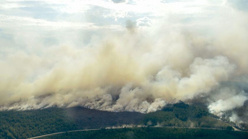 In this aerial photo showing the advancing fire around Ljusdal, Finland, as a wildfire sweeps throug