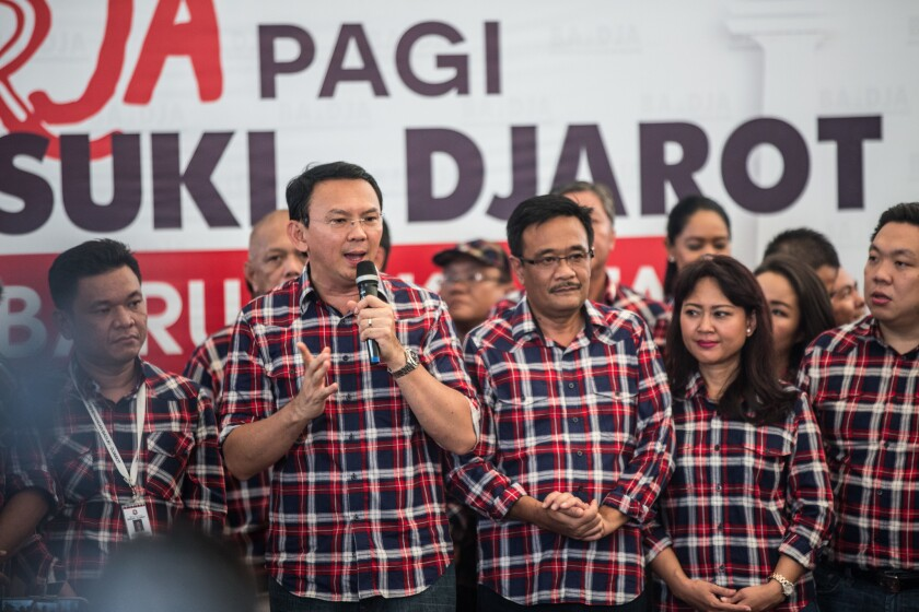Incumbent governor Basuki Tjahaja Purnama speaks during voting on Wednesday in municipal elections in Jakarta, Indonesia.