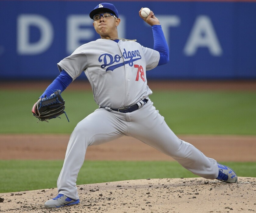 Los Angeles Dodgers' Julio Arias delivers a pitch during the first inning of a baseball game against the New York Mets on Friday, May 27, 2016, in New York.