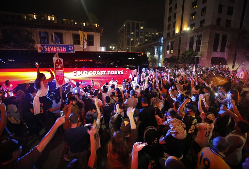 Thousands of fans surround the San Diego Padres team bus in the Gasla