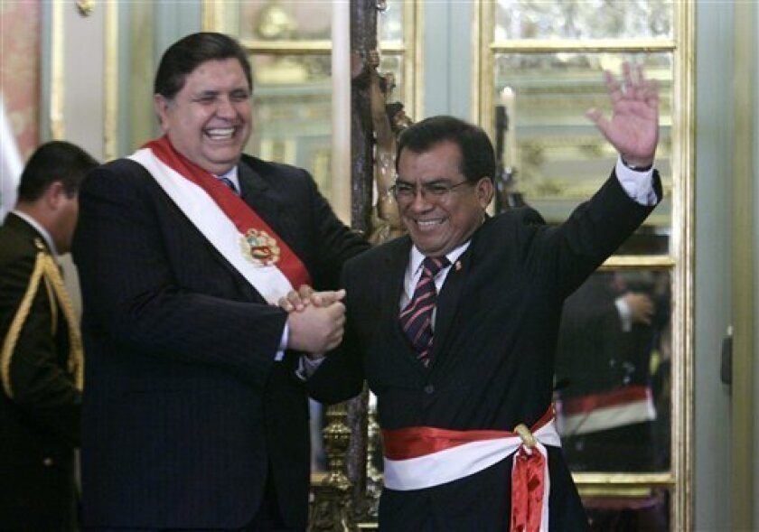 Peru's President Alan Garcia, left, shakes hands with his new Cabinet Chief Javier Velasquez during a swearing-in ceremony at the government palace in Lima, Saturday, July 11, 2009. (AP Photo/Karel Navarro)
