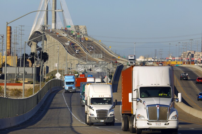 Trucks move across Terminal Island through the ports of Los Angeles and Long Beach.