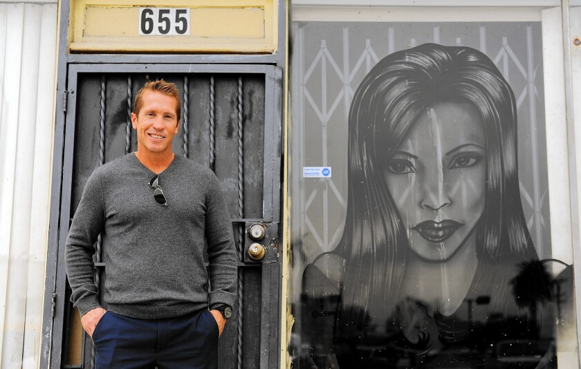Matt Crabbs, a commercial real estate agent, says interest in properties around Inglewood has grown after the Rams announced they were headed to town. Above, Crabbs outside a building on La Brea Avenue.