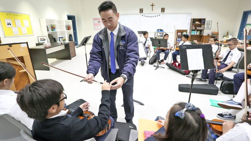 Kwang Nguyen, music director for Christ Cathedral Academy, said the arts help to develop the whole child and expand childrens' horizons.