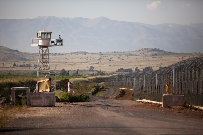 In this file photo, an unmanned U.N. watchtower stands on May 7, 2013, on the Israeli side of the border between the Israeli-annexed Golan Heights and Syria. Four U.N. peacekeepers were reportedly released after being held five days by Syrian rebels.