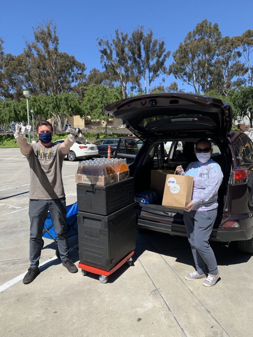 Scott Slater makes a San Diego Meals Ready Made delivery.
