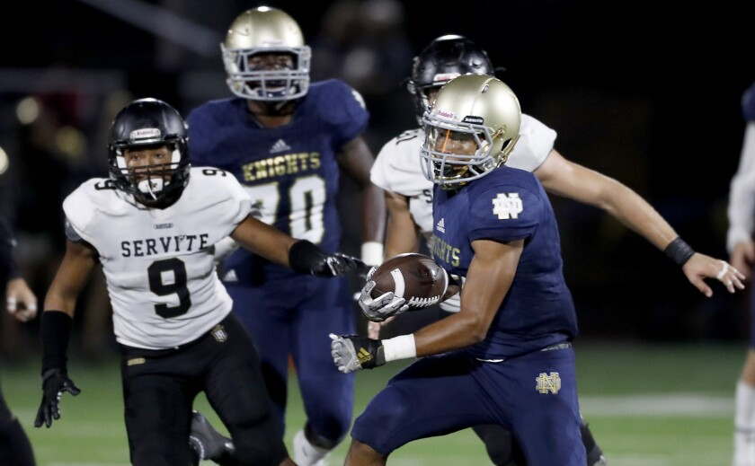 Sherman Oaks Notre Dame wide receiver Sean Guyton makes a catch during a 16-13 loss to Anaheim Servite.