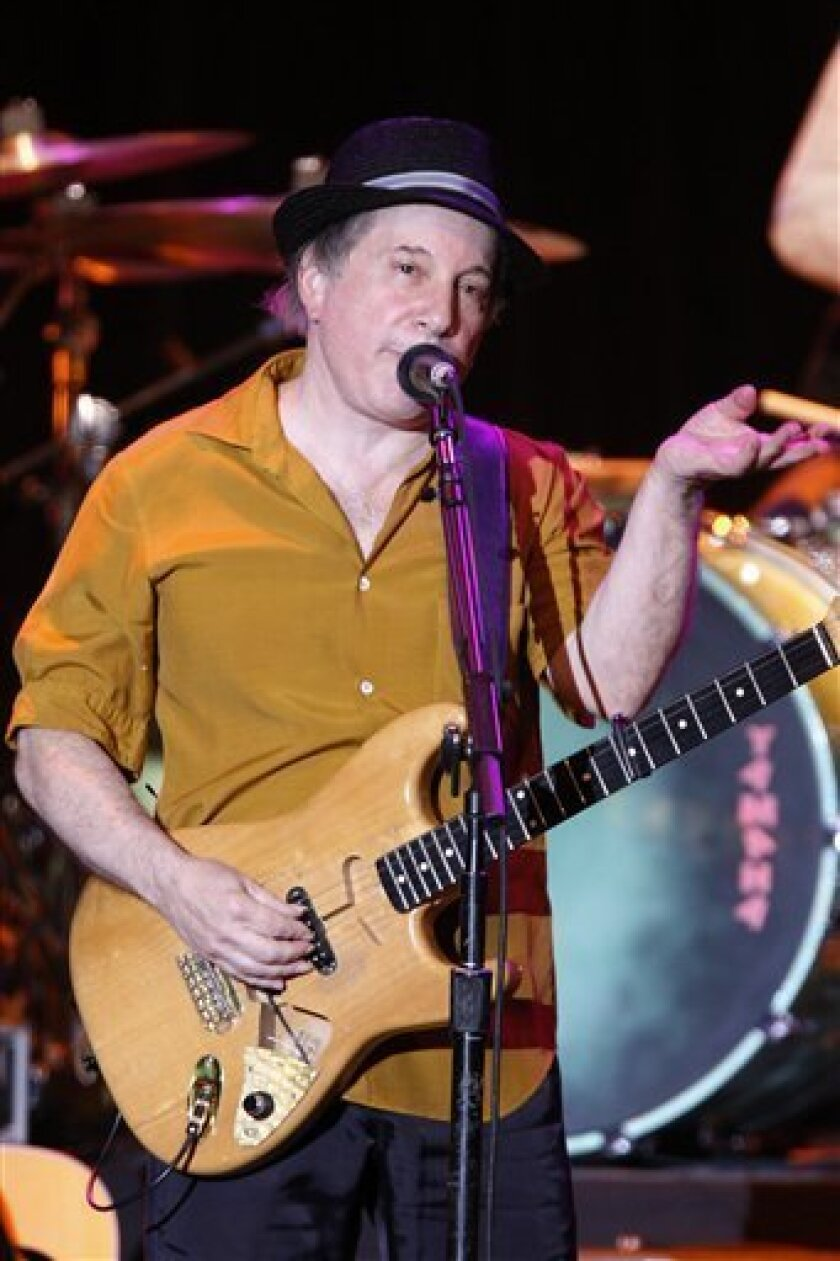In this July 9, 2008 file photo, singer and songwriter Paul Simon performs on the stage of the Stravinski hall during the 42nd Montreux Jazz Festival in Montreux, Switzerland. (AP Photo/Keystone, Jean-Christophe Bott, file)