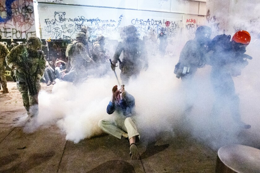 Federal agents clash with protesters in Portland, Ore.