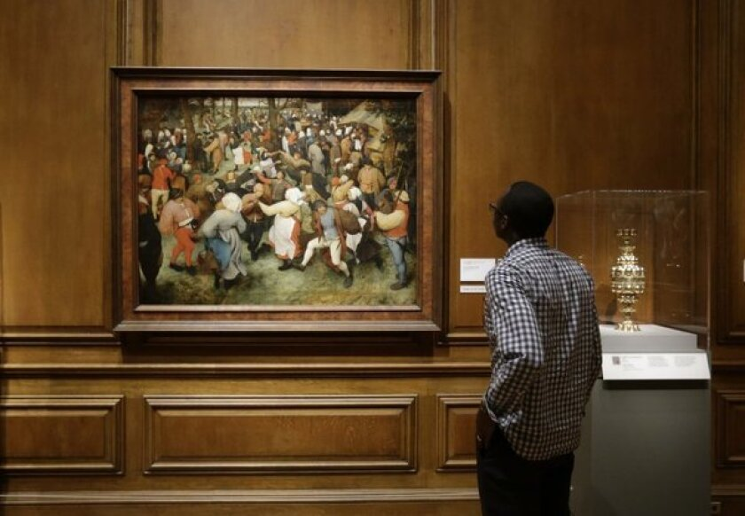 """The Wedding Dance"" by Pieter Bruegel the Elder is displayed at the Detroit Institute of Arts."
