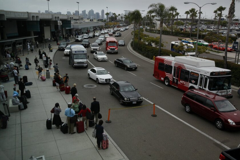 Traffic of cars and travelers at San Diego's airport.