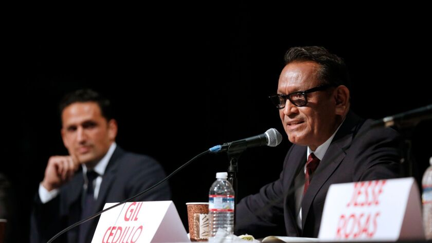 Challenger Joe Bray-Ali, left, and Councilman Gil Cedillo at a City Council District 1 candidates forum at Sotomayor Learning Academies complex on Feb. 16.