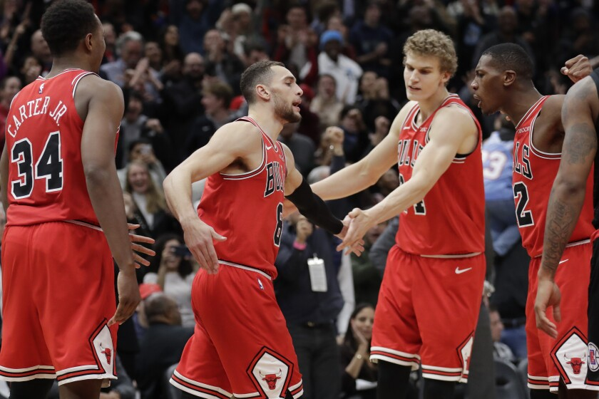 Bulls guard Zach LaVine, second from left, celebrates his three-point play in the final seconds Dec. 14, 2019.