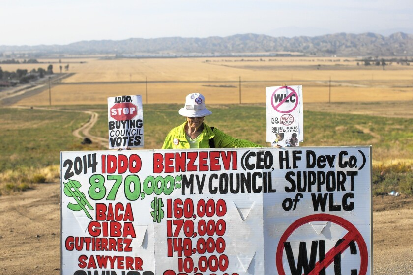 Riverside County resident Betty Masters protests the Moreno Valley City Council's support of developer Iddo Benzeevi's proposed World Logistics Center.