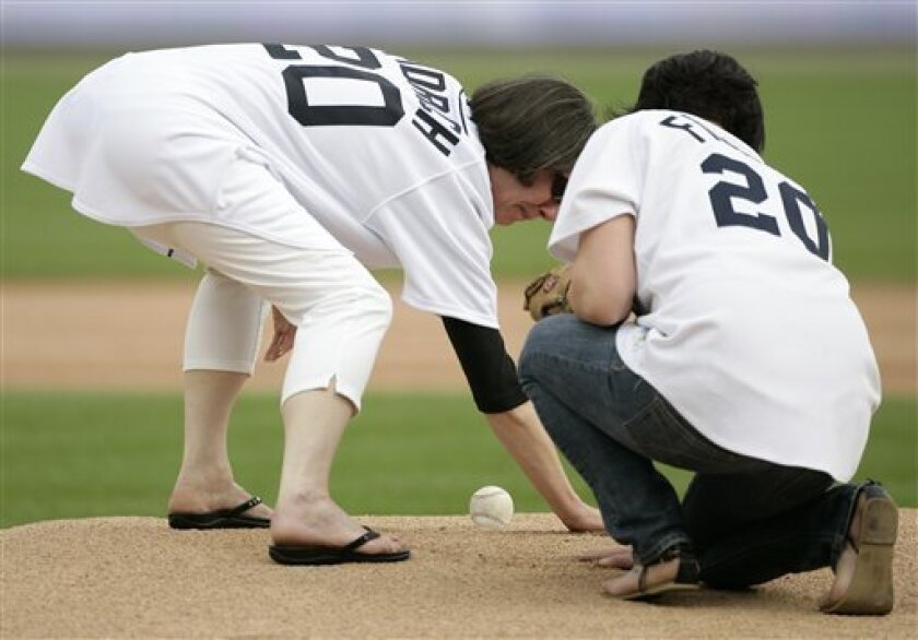 """Ann Fidrych, left, widow of former Detroit Tigers pitcher Mark """"The Bird"""" Fidrych, and their daughter Jessica, right, groom the mound, like Mark did before he pitched every inning, during a ceremony in his honor Friday, June 19, 2009, in Detroit. Fidrych, an All-Star for the Tigers in 1976, died in"""