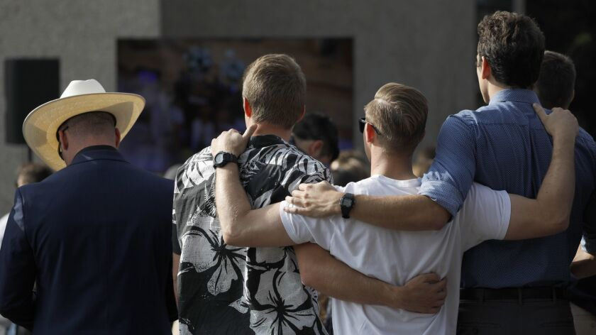 Friends and family gather at a memorial service for Justin Meek at Cal Lutheran University's Samuelson Chapel in Thousand Oaks.
