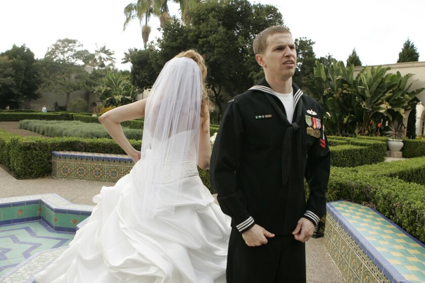 "Military service members, like this sailor who married in 2009, are being impersonated online by ""evil twin"" scammers claiming to be suitors. (Laura Embry/San Diego Union-Tribune/Zuma Press)"