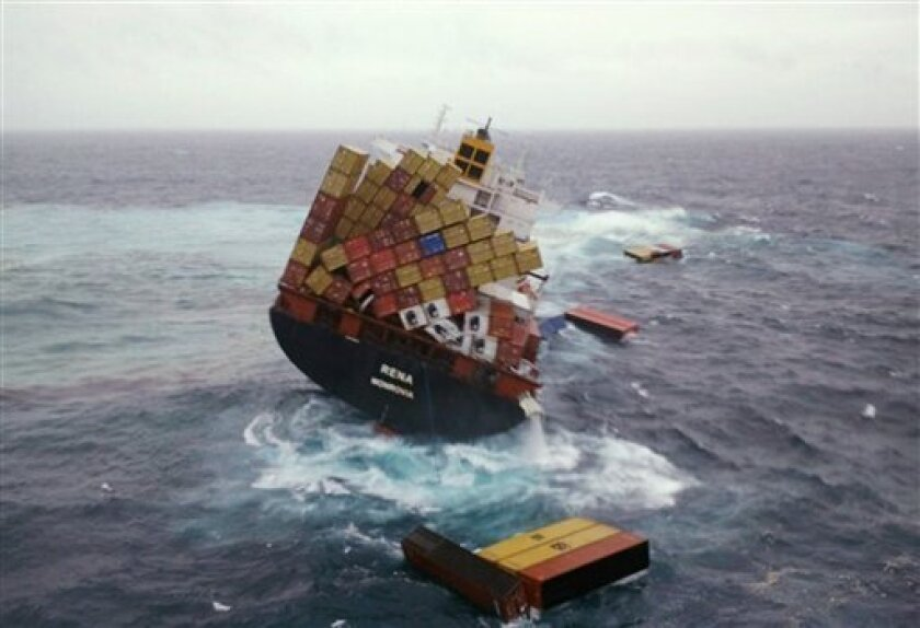In this photo provided by Maritime New Zealand, shipping containers float Wednesday, Oct. 12, 2011, in the water around the cargo ship Rena that has been foundering since it ran aground Oct. 5 on the Astrolabe Reef, about 14 miles (22 kilometers) from Tauranga Harbour, New Zealand. The condition of the stricken cargo ship stuck that is leaking oil worsened Wednesday, with about 70 containers falling overboard and the vessel moving onto a steeper lean. (AP Photo/Maritime New Zealand, Blair Harkness)