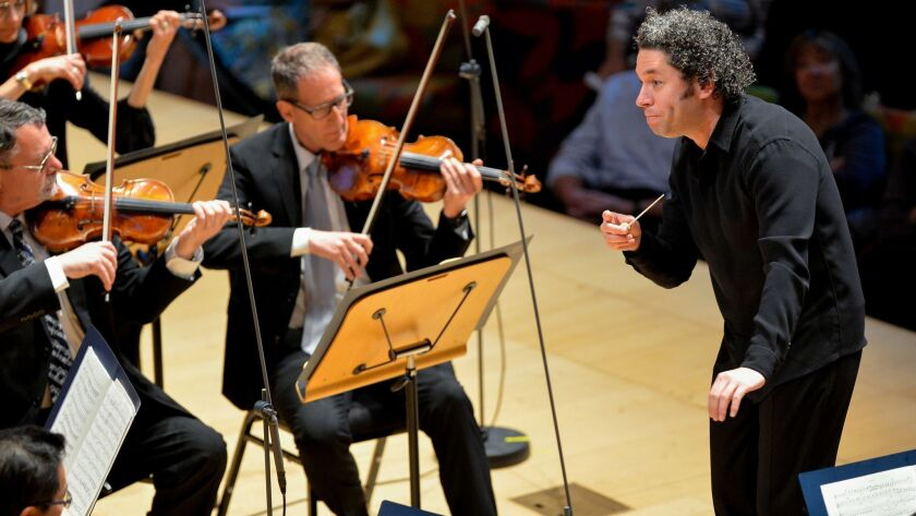 """Gustavo Dudamel conducts the Los Angeles Philharmonic in Schumann's Overture to """"Genoveva"""" at Walt Disney Concert Hall Friday."""