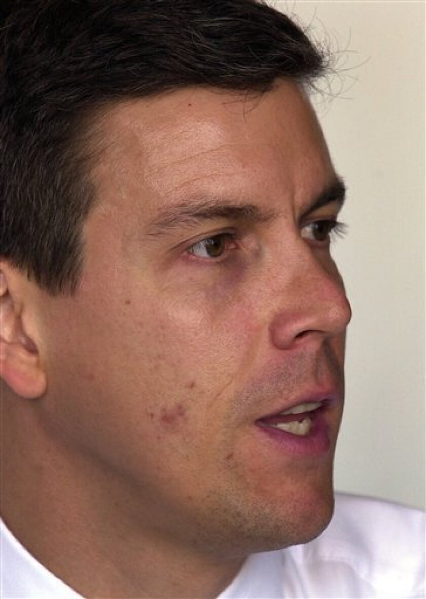 In this June 18, 2002 file photo, Arne Duncan, head of the Chicago Public Schools system, answers a question during an interview in Chicago. (AP Photo/Charles Bennett, File)