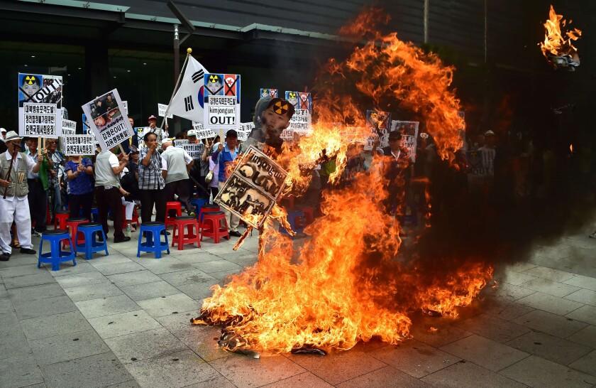 South Korean activists burn an effigy of North Korean leader Kim Jong Un at a rally in Seoul on Friday.
