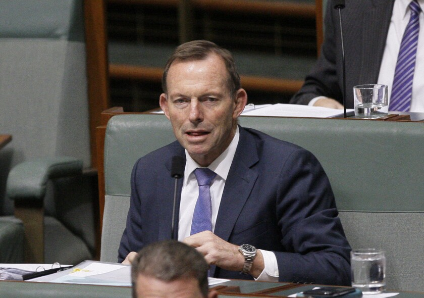 "FILE - In this Monday, Aug. 20, 2018 file photo, former Australian Prime Minister Tony Abbott listens to lawmakers speak in Parliament in Canberra, Australia. Prominent equality and environmental activists, including ""Lord of the Rings"" star Ian McKellen have urged the British government to drop plans to make former Australian Prime Minister Tony Abbott a U.K. trade advisor. Prime Minister Boris Johnson's government faced growing opposition Friday, Sept. 4, 2020 over reports it will appoint Abbott, who led a conservative Australian government between 2013 and 2015, to the U.K.'s Board of Trade. (AP Photo/Rod McGuirk, file)"