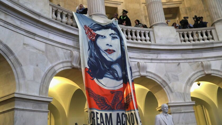 Immigration activists hang a banner in the Capitol building in Washington recently.