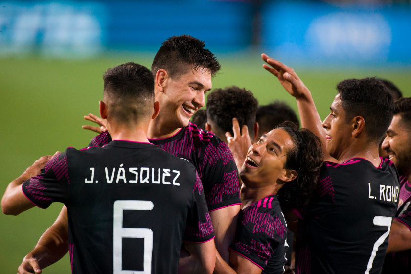 Mexico's Cesar Montes Castro celebrates with teammate Diego Lainez, right, and others after scoring against Panama.