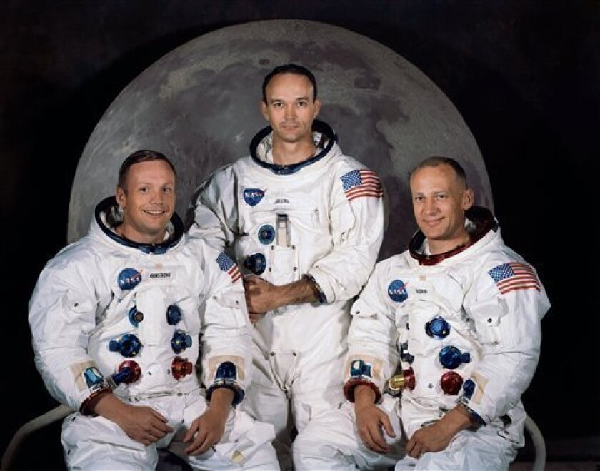 FILE - In this 1969 photo provided by NASA the crew of the Apollo 11 mission is seen. From left are Neil Armstrong, Mission Commander, Michael Collins,  Lt. Col. USAF, and Edwin Eugene Aldrin, also known as Buzz Aldrin, USAF Lunar Module pilot. The family of Neil Armstrong, the first man to walk on