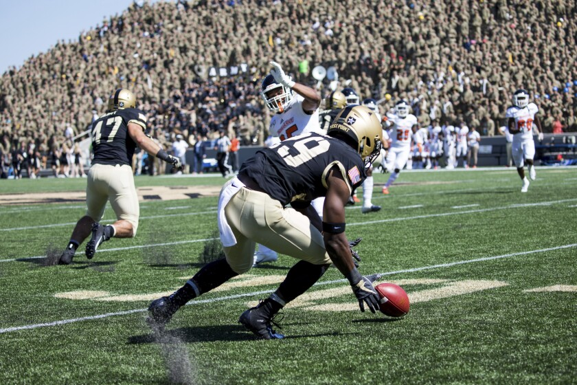Army running back A.J. Howard Jr. (29) recovers the ball during the first half of an NCAA college football game against Morgan State, Saturday, Sept. 21, 2019 in West Point, N.Y. (AP Photo/Julius Constantine Motal)