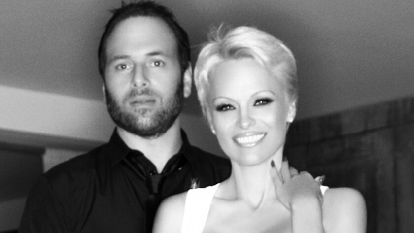 Rick Salomon and Pamela Anderson have reached a divorce settlement -- their second.