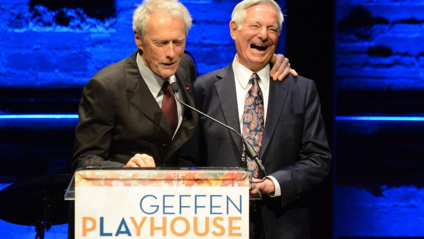 Bruce Ramer, at right with actor Clint Eastwood in 2013, helped President C.L. Max Nikias negotiate his exit package. He is also a lifetime trustee of USC.