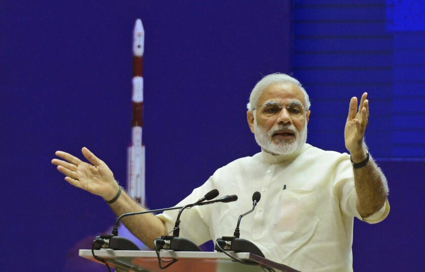 Indian Prime Minister Narendra Modi addresses a national meeting on space technology in New Delhi on Sept. 7.