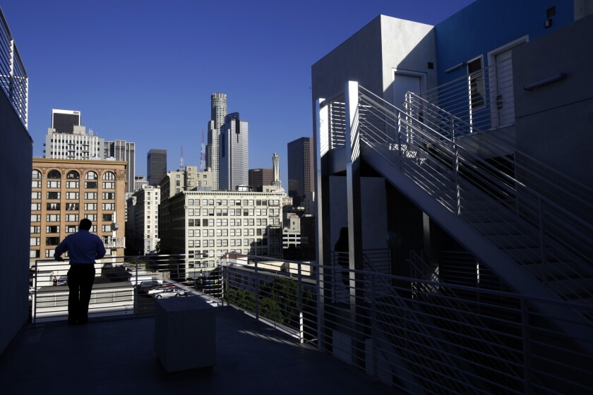 The Star Apartments building features a community garden, running track, exercise and art rooms and a library -- plus a view of the downtown L.A. skyline.