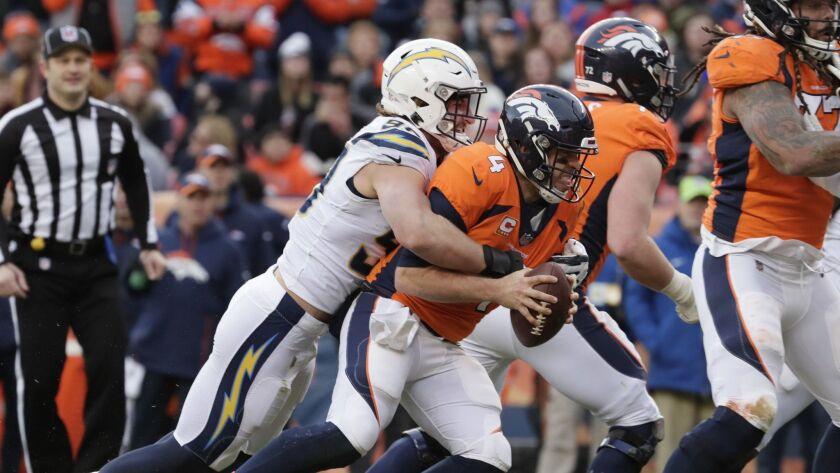 DENVER, CO, SUNDAY DECEMBER 30, 2018 - Chargers defensive end Joey Bosa sacks Broncos quarterbacl Ca