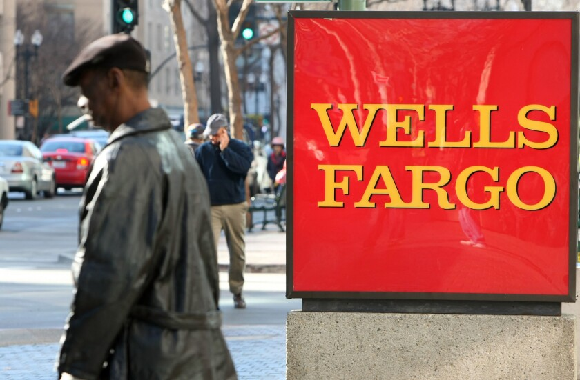 Prudential has suspended sales of insurance policies through Wells Fargo after a lawsuit alleged that bank workers sold policies to customers who did not want them.