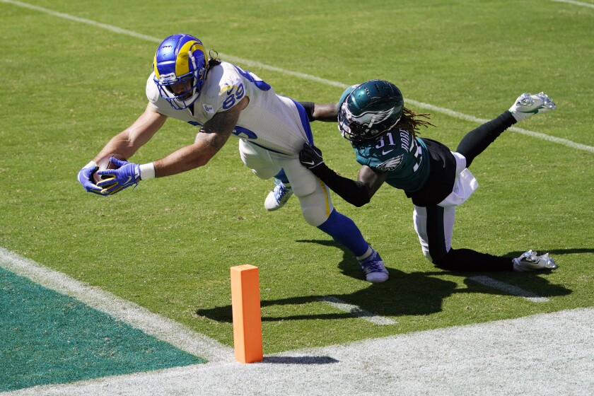 The Rams' Tyler Higbee reaches for a touchdown against the Philadelphia Eagles' Nickell Robey-Coleman.