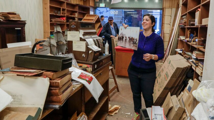 Rachel Bernstein Stark helps her father, Leonard Bernstein, pack items at Caravan Book Store, which closed after nearly 64 years in downtown Los Angeles.