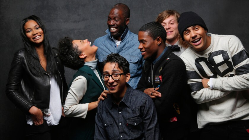 """Chanel Iman, left, Kiersey Clemons, Tony Revolori, director Rick Famuyiwa (rear), Shameik Moore, Blake Anderson and Quincy Brown from the movie """"Dope"""" at the Sundance Film Festival on Jan. 24, 2015. (For the record: An earlier version of this caption misidentified the placement of director Rick Famuyiwa.)"""