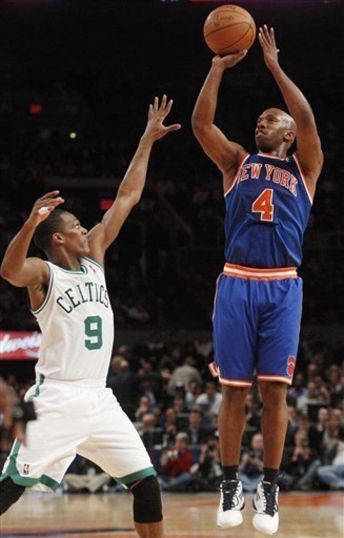 New York Knicks' Chauncey Billups (4) shoots over Boston Celtics' Rajon Rondo (9) during the first half of an NBA basketball game Monday, March 21, 2011, in New York. (AP Photo/Frank Franklin II)
