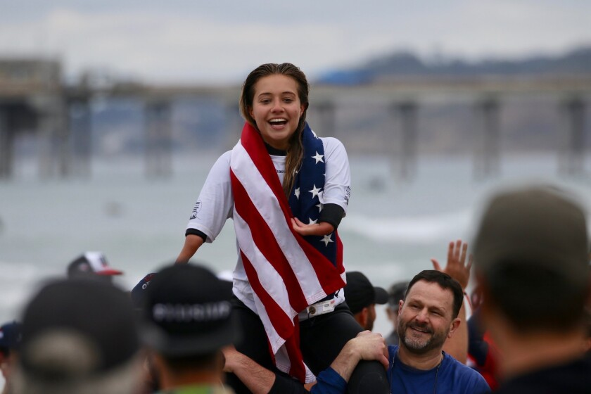 "Gold medalist Olivia ""Liv"" Stone, 17, of Carlsbad and her dad, Tom Stone, right, celebrate at the 2020 International Surfing Association AmpSurf World Para Surfing Championship in La Jolla on Sunday, March 15."