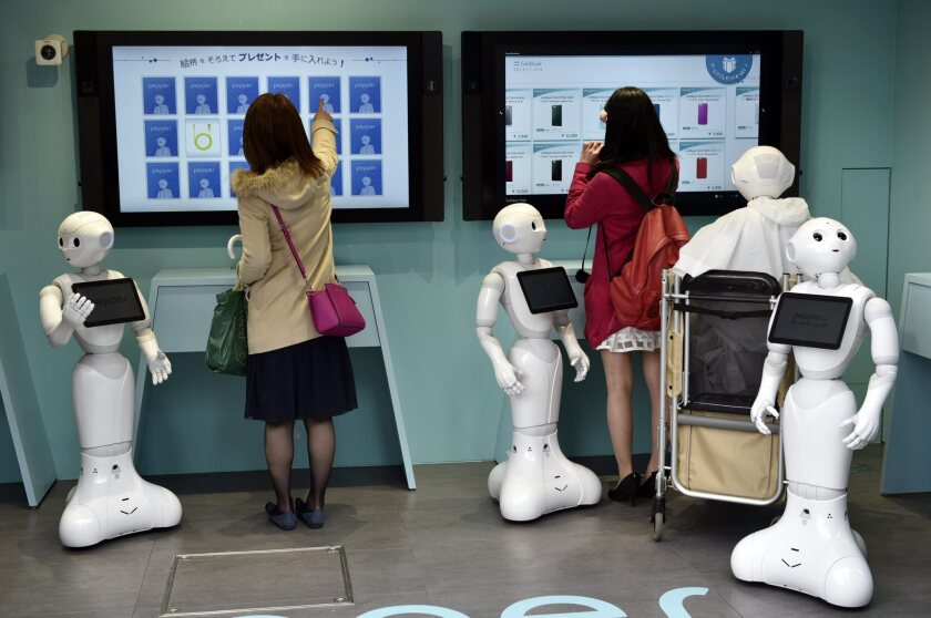 Two women visit a newly opened robot-staffed store run by telecommunications and mobile phone carrier SoftBank Corp. in Tokyo, Japan on March 24.