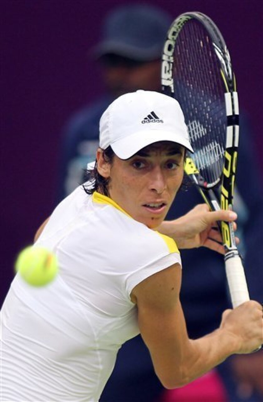 Francesca Schiavone of Italy returns the ball during her match against France's Marion Bartoli  on the Second day of the WTA Qatar Ladies Open in Doha, Qatar,Tuesday, Feb. 12, 2013. (AP Photo/Osama Faisal)